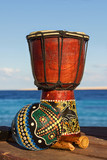 maracas and ethnic drum on the beach
