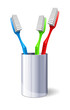 Three Color Toothbrushes In Metal Glass