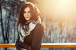 Sunny outdoor winter portrait of young attractive woman