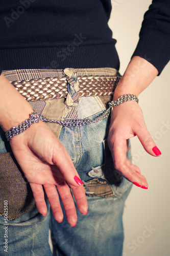 Female buttocks with handcuffs