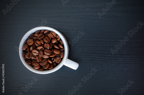 coffee cup on black wood table