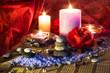 four candles camellias little stones and salt