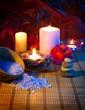 four candles camellias stones and salt vertical
