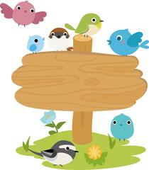木の立札と小鳥たち