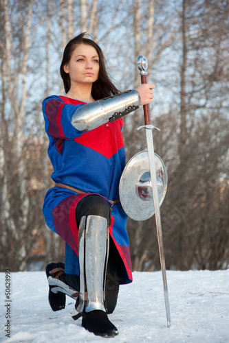 Girl in armor with a sword knight
