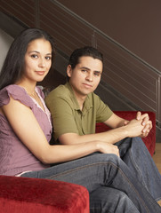 Portrait of couple sitting on couch together