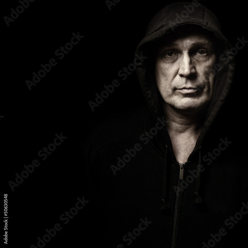 Portrait of the man in a hood