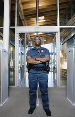 Security officer standing by entranceway