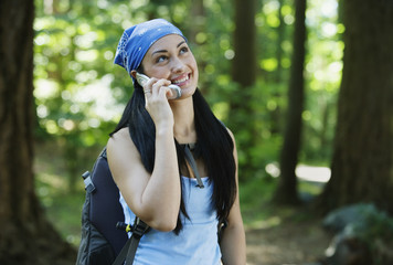 Hiking woman on mobile phone