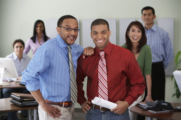 Group of office coworkers smiling at camera