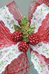 Red and white bow is attached to the gift.