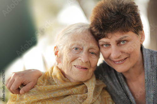 Portrait of happy old grandmother with daughter.