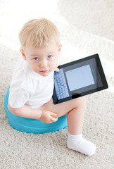 little boy on the chamder with tablet pc