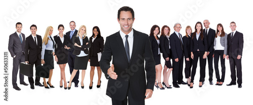Portrait of happy businessman and his team