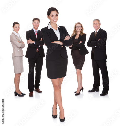 Portrait of happy businesswoman and her team