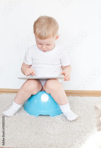 little boy on potty with tablet pc