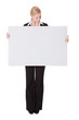 Businesswoman presenting empty banner