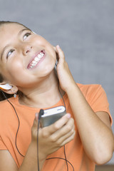 Close up of girl listening to music with headset