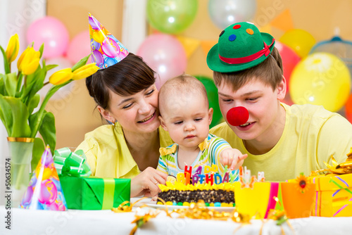 family celebrating first baby's birthday