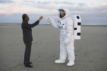 Astronaut and old man saluting each other