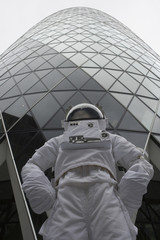 Low angle view of an astronaut standing by a skyscraper