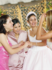 Bride celebrating with her bridesmaids
