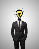 businessman with lamp instead of head on a gray background