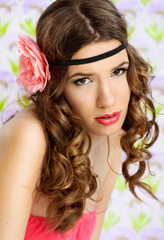 Portrait of  beautiful woman with a flower