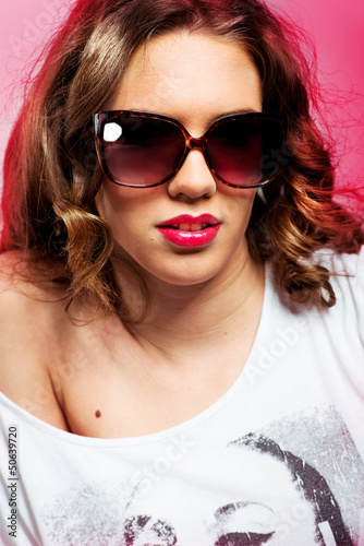 Fashion portrait of  beautiful woman with sunglasses