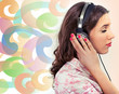 Woman with earphones over a colorful background