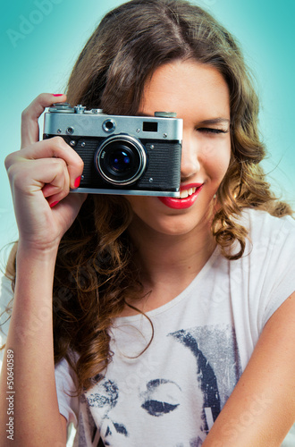 Woman with an old camera taking a photo