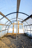 Homemade plastic arch empty  greenhouse in winter