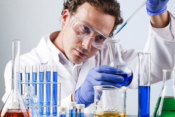 lab technician controlling colour of chemical solution