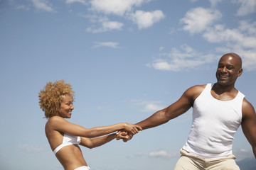 African couple playing outdoors