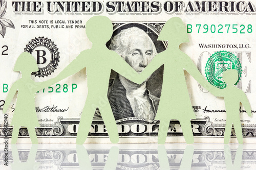 Paper family on the one dollar background