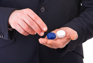 Business man with contact lens case.