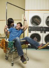 Asian couple in Laundromat