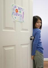 Asian girl in bedroom doorway