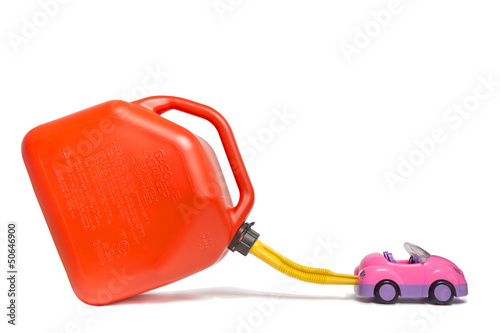 refueling toy car from plastic gas tank. comic concept.