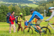 Tourists hiking and riding mountain bikes summer nature