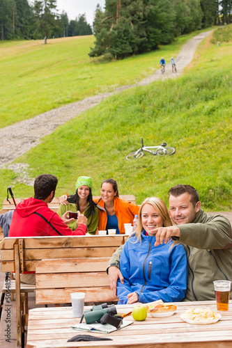 Young tourists in nature sitting bench