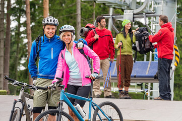 Mountain bikes couple and hikers after chair lift