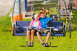 Couple on chair lift enjoying landscape