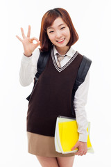 Young Asian student show okay sign