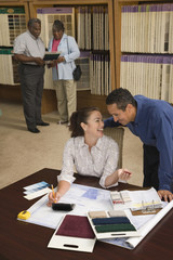 Multi-ethnic couple looking at flooring samples
