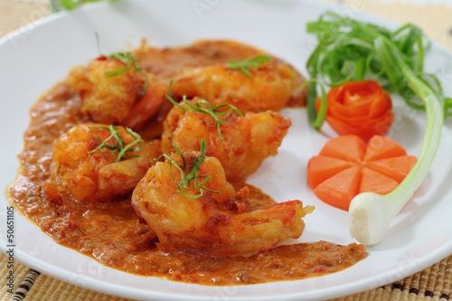 Fried prawn balls in red curry.