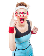 Angry funny fitness woman gesturing at warning