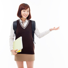 Young pretty Asian student indicate side space