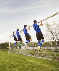 Multi-ethnic male soccer players exercising