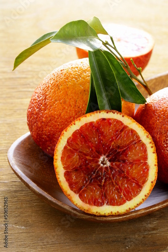 red (bloody) oranges  on a wooden background